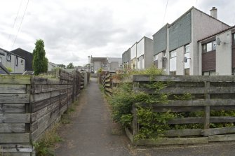 View of access lanes running between housing at Mingle Place and Muirepark Court, Bo'ness, taken from the East. This photograph was taken as part of the Bo'ness Urban Survey to illustrate the character of the Hillcrest and Brewlands Area of Townscape Character.