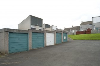 View of garages and communal car parking area off Muirepark Court, Bo'ness, taken from the North-West. Houses are accessed from the car parking via a series of pedestrian pathways. This photograph was taken as part of the Bo'ness Urban Survey to illustrate the character of the Hillcrest and Brewlands Area of Townscape Character.