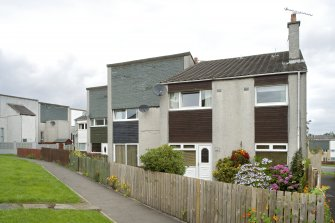 View of terraced housing at 13-19 Mingle Place, Bo'ness, taken from the South-East. This photograph was taken as part of the Bo'ness Urban Survey to illustrate the character of the Hillcrest and Brewlands Area of Townscape Character.