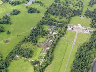 Oblique aerial view of Hopetoun House and policies, taken from the ENE.