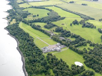 General oblique aerial view of Hopetoun House and policies, taken from the NE.