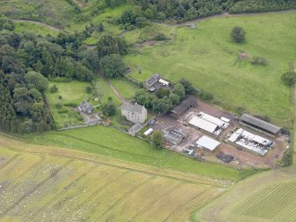 Oblique aerial view of Midhope Castle and farm, taken from the NNW.