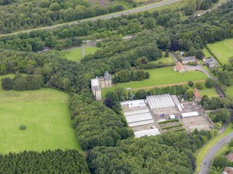 Oblique aerial view of Kinneil House and Duchess Anne Cottages, Bo'ness, taken from the SSE.