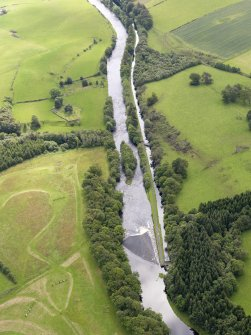 Oblique aerial view of Deanston Mills weir, taken from the NW.