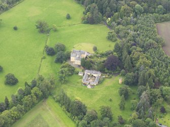 Oblique aerial view of Gargunnock House and stables, taken from the NW.