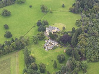 Oblique aerial view of Gargunnock House and stables, taken from the WNW.