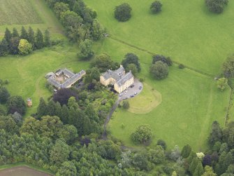 Oblique aerial view of Gargunnock House and stables, taken from the SSW.