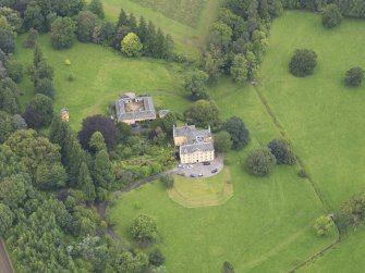 Oblique aerial view of Gargunnock House and stables, taken from the SSE.