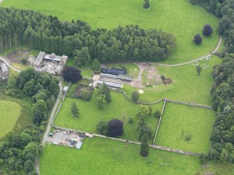 Oblique aerial view of Jardine Hall stables and walled garden, taken from the NW.