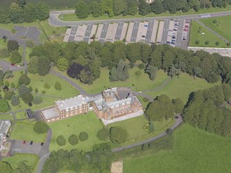 Oblique aerial view of Crichton Royal Hospital, centred on Rutherford House, taken from the SW.