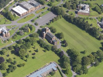 Oblique aerial view of Crichton Royal Hospital, centred on Crichton Memorial Church, taken from the WNW.