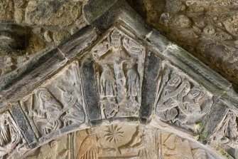 Detail of the 16th century tomb of Alasdair Macleod, 8th Chief of Macleod. Central portion of arch showing the Saviour on a cross held by the Father, flanked by (right) James the Greater and (left) St ?Peter and St John.