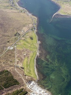 General oblique aerial view of the remains of fish traps near Sconser golf course, and the remains of Achadh Mor township, field system and lazy beds extending towards Sconser, Skye, taken from the ESE.