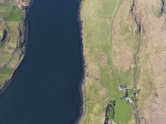 Oblique aerial view of the possible remains of a fish trap at Skerinish and the nearby remains of a field system and lazy beds, Skye, taken from the SSE.