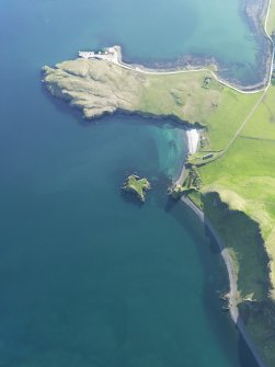 Oblique aerial view of Coroghan Castle and the pier on Canna, taken from the ENE.