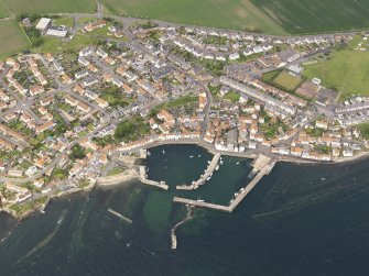 General oblique aerial view of St Monans centred on the harbours, taken from the SSE.