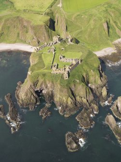 General oblique aerial view of Dunnottar Castle near Stonehaven, taken from the E.