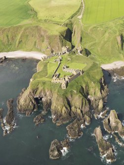 General oblique aerial view of Dunnottar Castle, taken from the E.