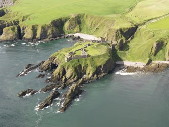 General oblique aerial view of Dunnottar Castle, taken from the NE.
