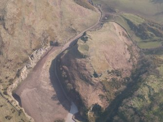 Oblique aerial view of Castle Craig, looking SSW.