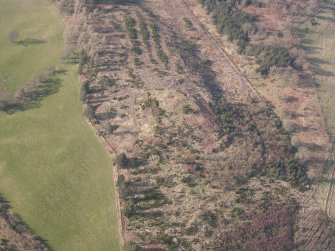 Oblique aerial view of Ogle Hill, looking NNW.