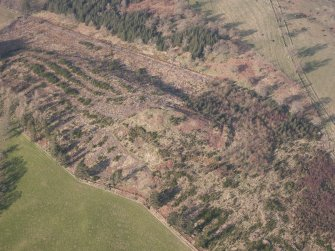 Oblique aerial view of Ogle Hill, looking N.