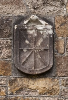 Detail of heraldic shield to right of east entrance