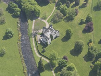 Oblique aerial view of Cortachy Castle, taken from the WNW.