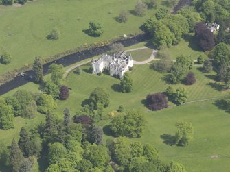 Oblique aerial view of Cortachy Castle, taken from the SW.