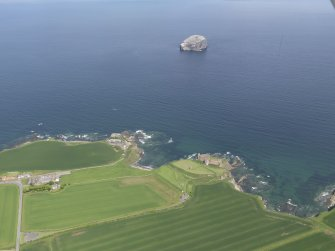 General oblique, aerial view of the East Lothian coast centred on Tantallon Castle with the Bass Rock in the background, taken from the SSW.