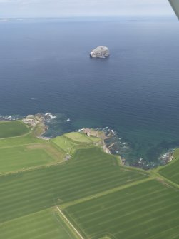 General oblique aerial view of the East Lothian coast centred on Tantallon Castle with the Bass Rock in the background, taken from the SSW.