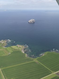 General oblique aerial view of the East Lothian coast centred on Tantallon Castle with the Bass Rock in the background, taken from the S.