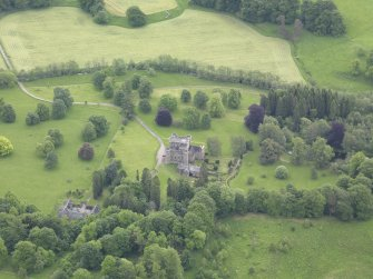 Oblique aerial view of Monzie Castle, taken from the NW.