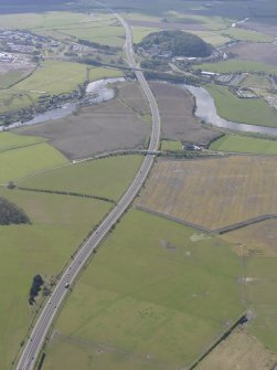 General oblique aerial view along the M9 with Craigforth House in the distance, looking S.