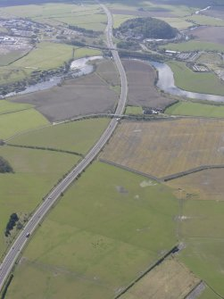 General oblique aerial view along the M9 with Craigforth House in the distance, looking SSE.