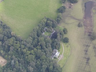 Oblique aerial view of Chesters House, taken from the SW.