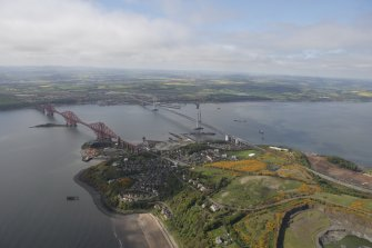 General oblique aerial view of Forth Rail Bridge, Forth Road Bridge, North Queensferry and construction of Queensferry Crossing, looking SW.