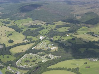 General oblique aerial view of Blair Castle during the Scouts Blair Atholl Jamborette beyond, looking NW.