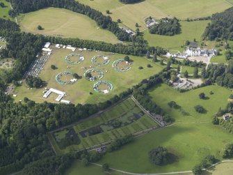 Oblique aerial view of Blair Castle grounds during the Scouts Blair Atholl Jamborette, looking SW.