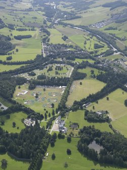 General oblique aerial view of Blair Castle grounds during the Scouts Blair Atholl Jamborette, looking SSE.