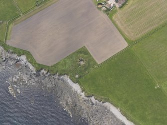 Oblique aerial view centred on the Hillock of Burroughston broch, looking W.