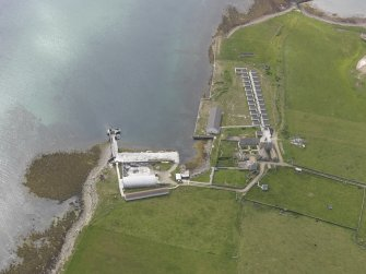 Oblique aerial view centred on Bountifur Pier, Papa Stronsay, looking west.