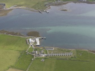 Oblique aerial view centred on Bountifur Pier, Papa Stronsay, looking S.