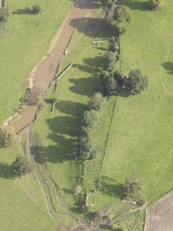 General oblique aerial view of Herdmanston Chapel with adjacent West Gate, looking to the NW.