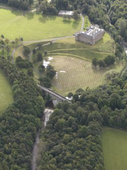 General oblique aerial view of Dalkeith House with adajacent Montague Bridge, looking to the S.