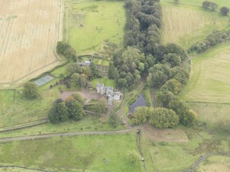 Oblique aerial view of Cakemuir Castle, looking to the E.