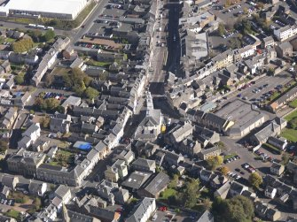 General oblique aerial view of Lanark High Street centred on St Nicholas Church, taken from the WSW.
