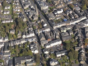 General oblique aerial view of Lanark High Street centred on St Nicholas Church, taken from the SSW.
