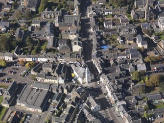 General oblique aerial view of Lanark High Street centred on St Nicholas Church, taken from the ESE.