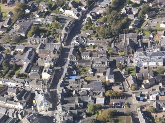 General oblique aerial view of Lanark High Street centred on St Nicholas Church, taken from the E.
